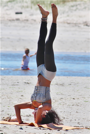 head stand on beach